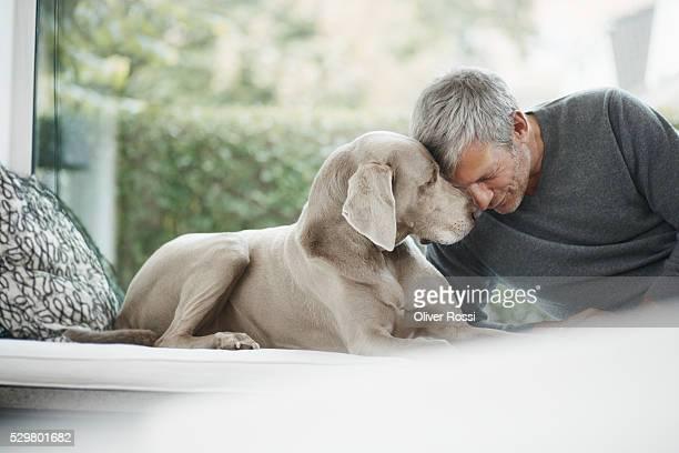 Mature man close to dog