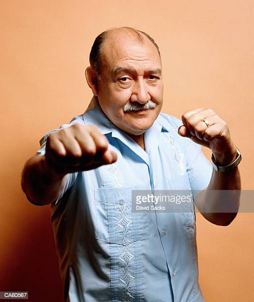 Mature man doing boxing gesture