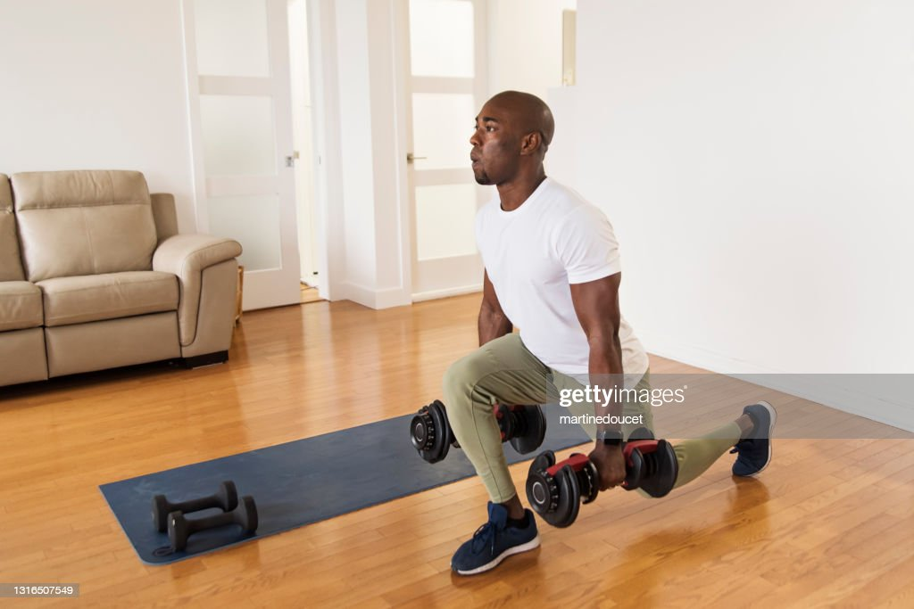 Mature man doing exercise at home. : Stock Photo