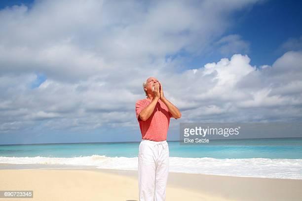 Mature Man doing Yoga At Pristine Beach