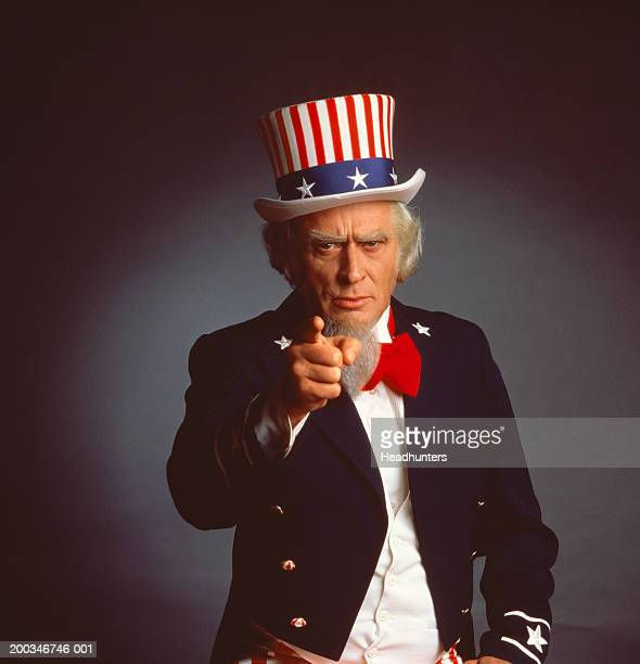mature man dressed as 'uncle sam' pointing finger - headhunters stock pictures, royalty-free photos & images