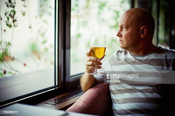 Mature Man drinking beer alone