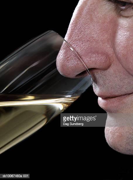 Mature man drinking champagne, close-up