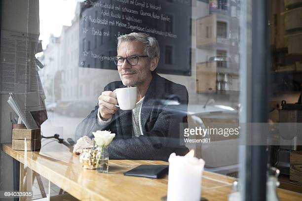 Mature man drinking coffee in a cafe