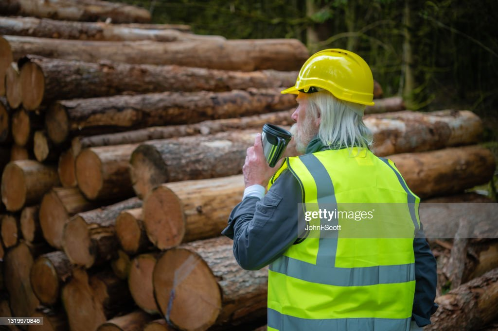 Mature man drinking from a reusable coffee cup : Stock Photo