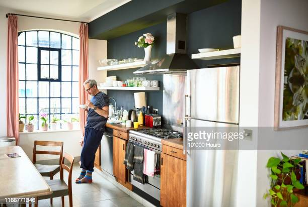 mature man eating breakfast in the morning - sunday stock pictures, royalty-free photos & images