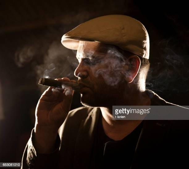 Mature man enjoying a cigar.
