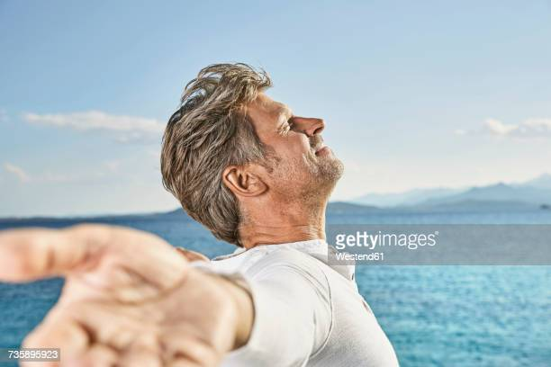 Mature man enjoying sunlight