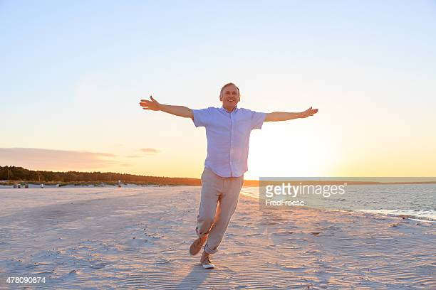 Mature man enjoying the beach
