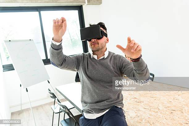 mature man entartains his self with virtual reality device simulator