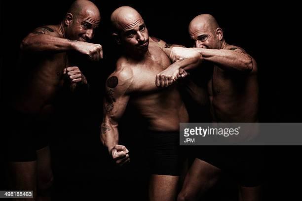 Mature man fighting, composite image