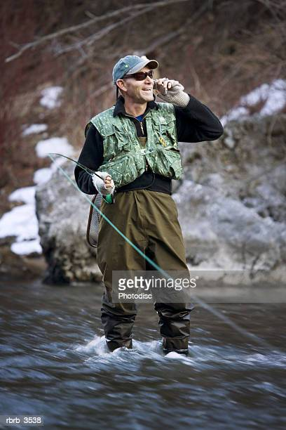 Mature man fly-fishing in a river