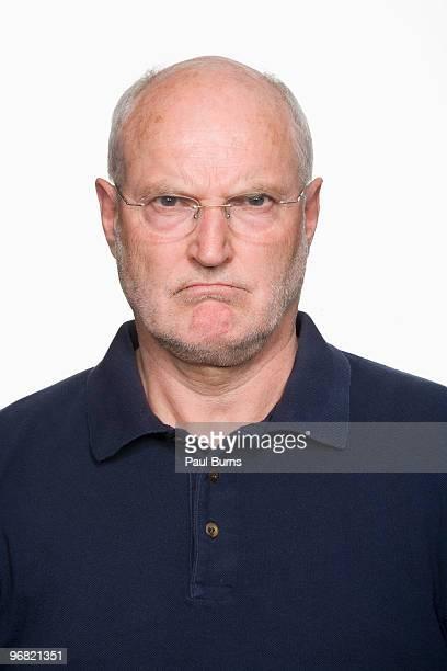 Mature man frowning