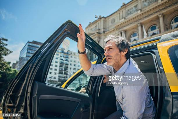 mature man getting out of the cab - getting out stock pictures, royalty-free photos & images