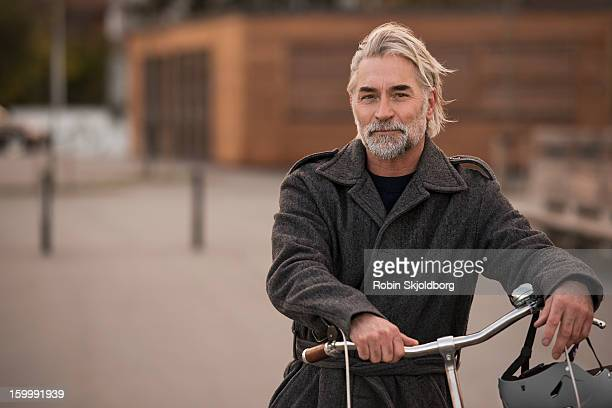 mature man hair with bicycle and helmet - robin skjoldborg stock pictures, royalty-free photos & images