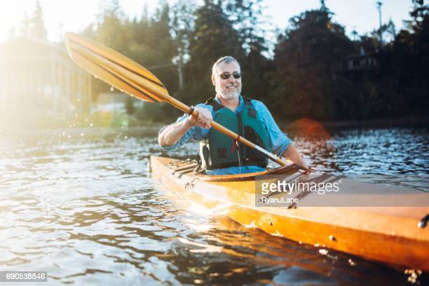 Mature Man Has Fun Kayaking