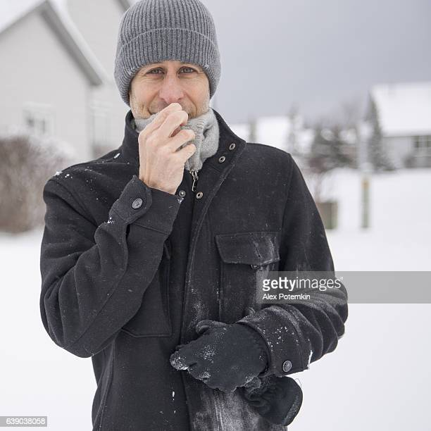 Mature man have fun outdoor under the snowfall