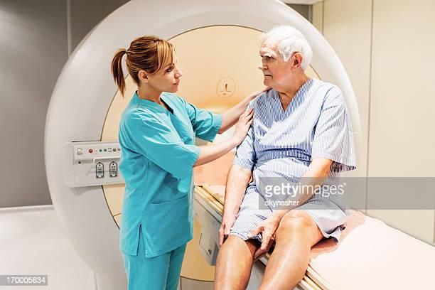Mature man having a medical examination via MRI scan.