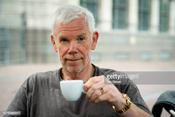 Mature man having coffee.
