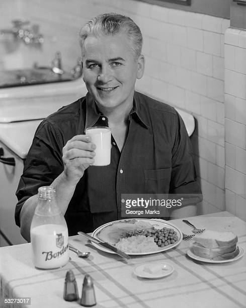 Mature man having milk w/dinner