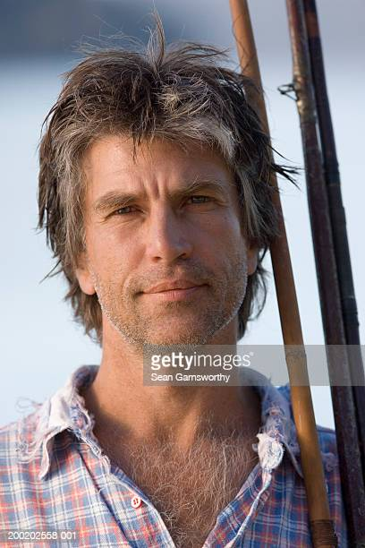 mature man holding fishing rods, outdoors, close-up, portrait - hairy chest stock photos and pictures