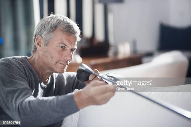 Mature man holding golf club
