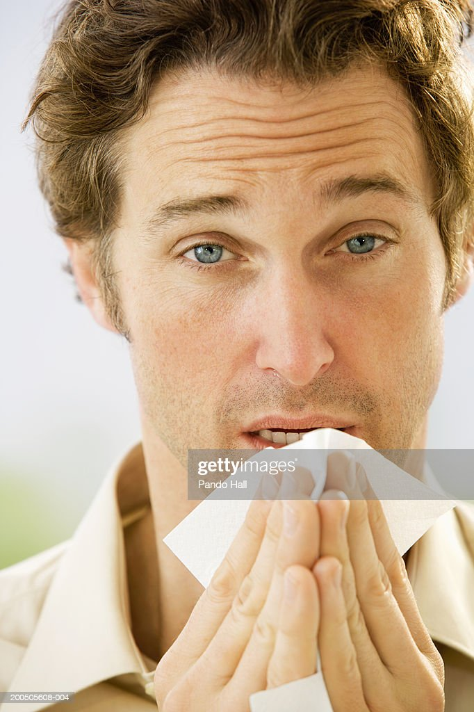 Mature man holding tissue, close-up, portrait : Stock Photo
