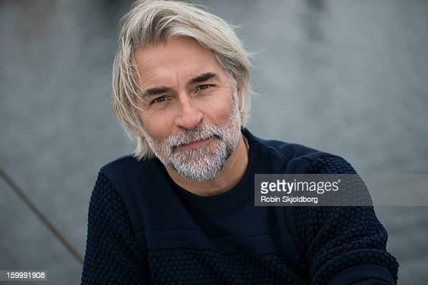 mature man in blue sweater - denmark stock pictures, royalty-free photos & images