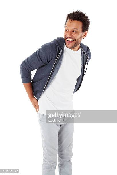 mature man in casuals looking away laughing - three quarter length stock pictures, royalty-free photos & images