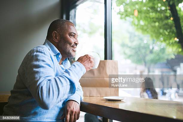 Mature Man in Coffee Shop