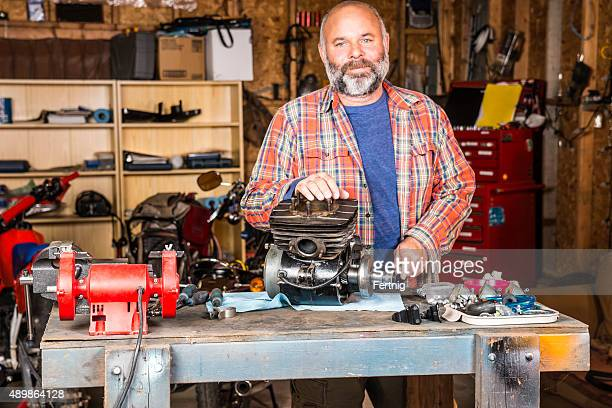 Mature man in his motorcycle workshop