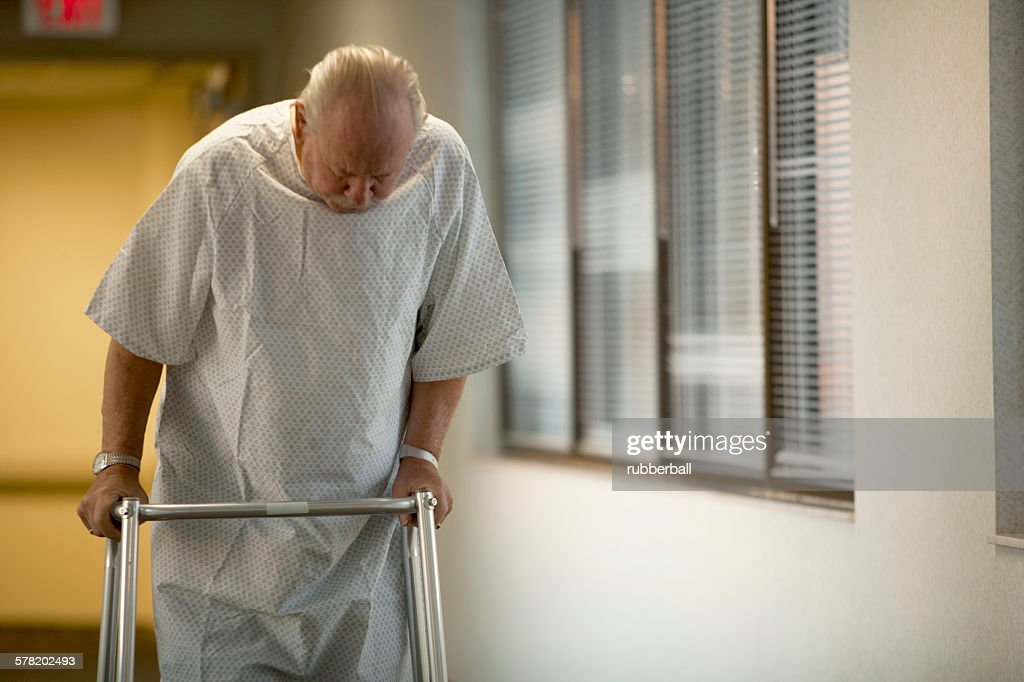 Mature Man In Hospital Gown With Walker Stock Photo | Getty Images