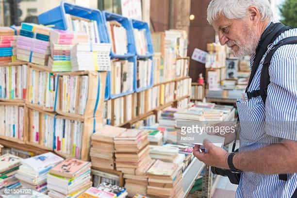 Mature man in Japanese bookstore