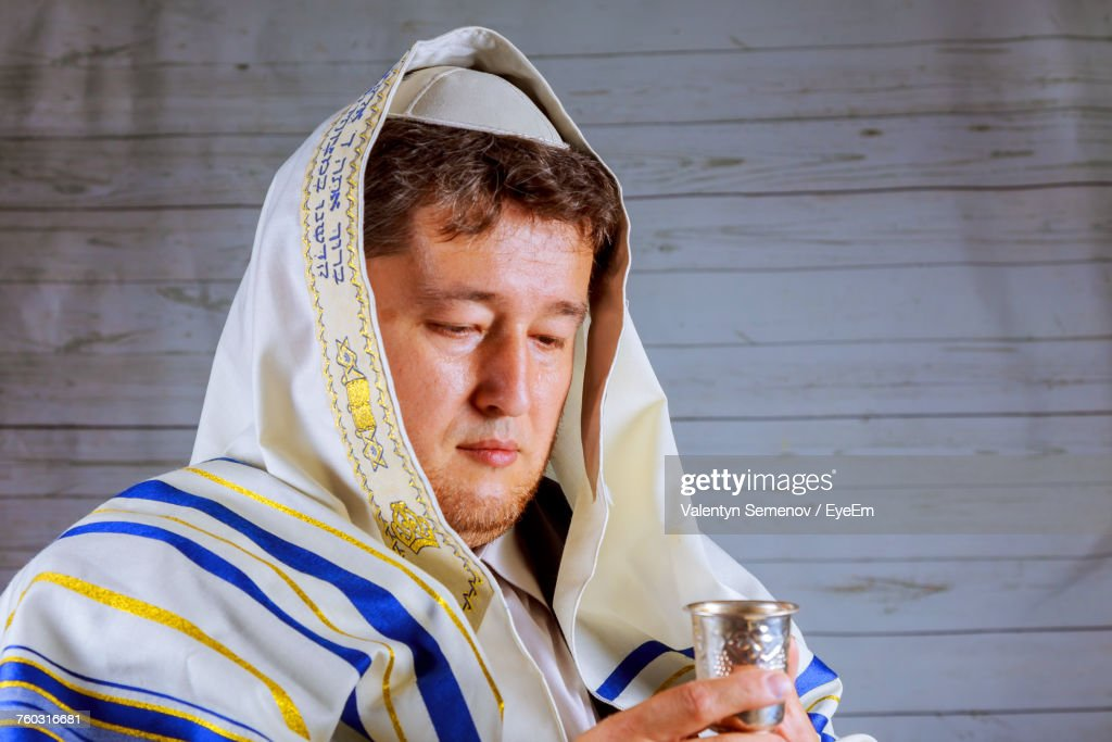 Mature Man In Jewish Prayer Shawl Holding Kiddush Cup : Stock Photo