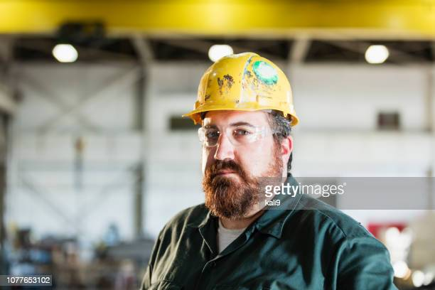 mature man in metal fabrication plant - eye protection stock pictures, royalty-free photos & images