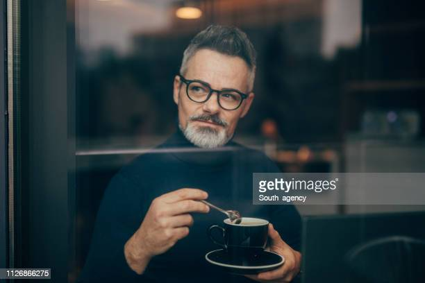 mature man in the coffee shop - suave stock pictures, royalty-free photos & images