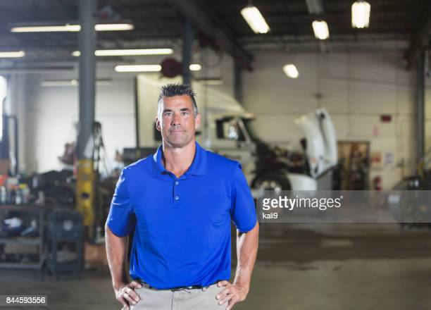 mature man in vehicle repair shop - one mature man only stock pictures, royalty-free photos & images