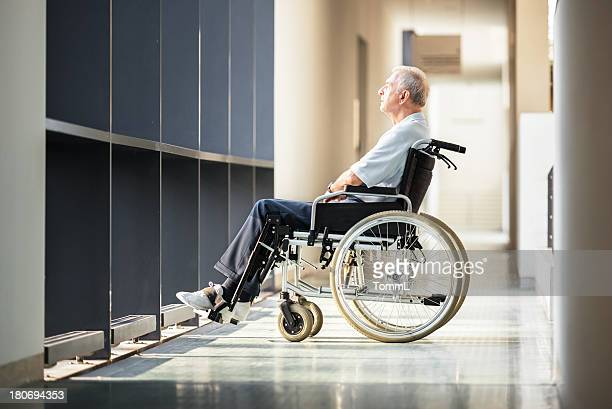 mature man in wheelchair - waiting stock pictures, royalty-free photos & images