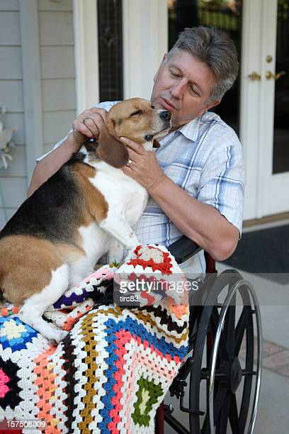 Mature man in wheelchair with beagle