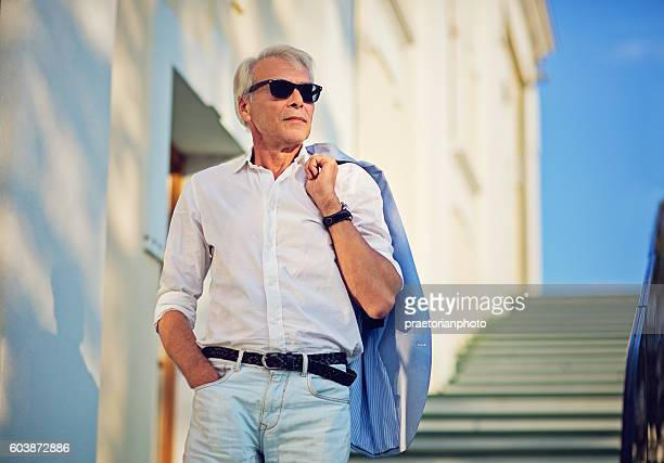 Mature man is walking down the stairs