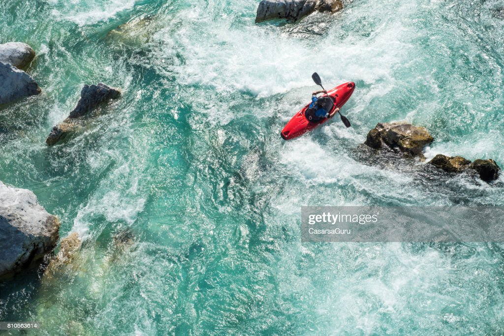 Mature Man Kayaking On  River Soca Rapids - High Angle View : Stock Photo