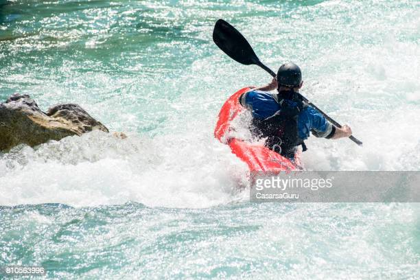 Mature Man Kayaking On The Turquoise Water Of River Soca - Slovenia