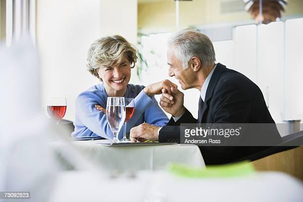Mature man kissing hand of senior woman