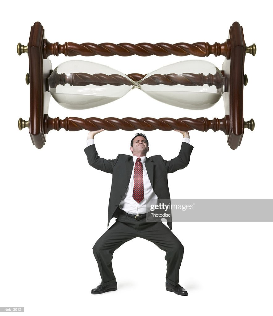 Mature man lifting an hourglass : Foto de stock