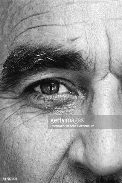mature man, looking at camera, close-up of eye, black and white - extreme close up stock pictures, royalty-free photos & images