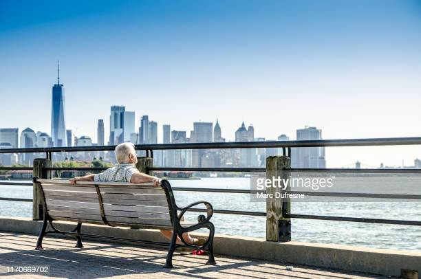 mature man looking at manhattan - new jersey stock pictures, royalty-free photos & images