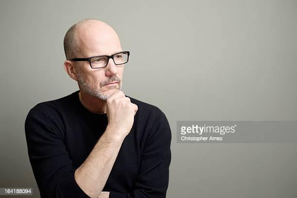 Mature Man Looking Away and Thinking