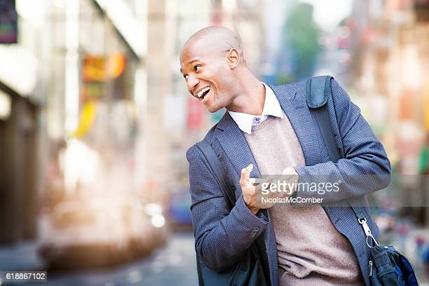 Mature man looks back smiling as he crosses the street