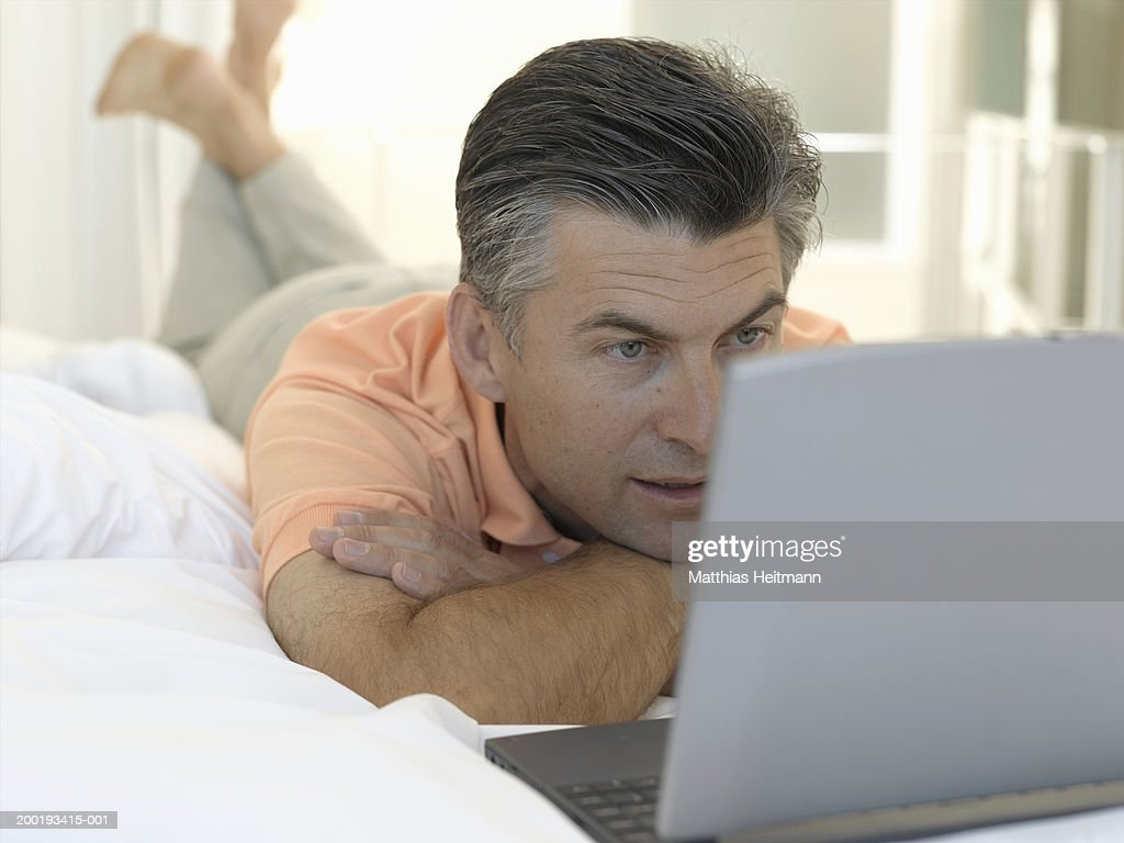 Image result for mature man in bed looking at computer