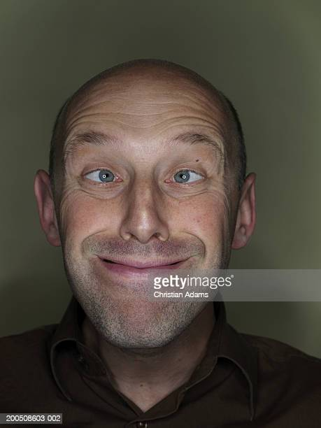 Mature man making funny face, close-up